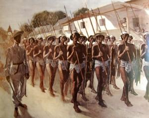Truppe Igorot armate di lancia, scudo e ascia